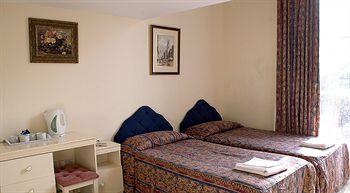 - Palace Court Hotel